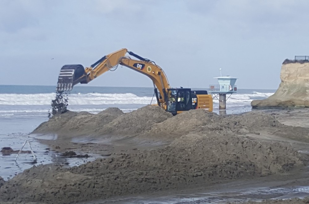 Excavaot Removing Sand From Inlet