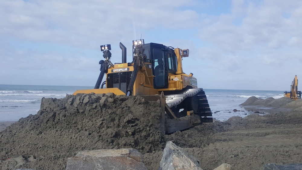Moving sand to the sides of the inlet opening